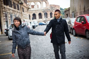 Walking together hand in hand during a photographer photo tour session in Rome