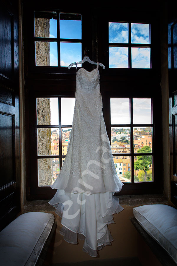 The bridal dress photographed hanging from a window Castle Odescalchi Italy