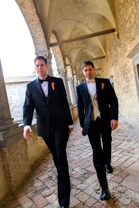 Groom and best men walking to the wedding ceremony in Castello Odescalchi Italy