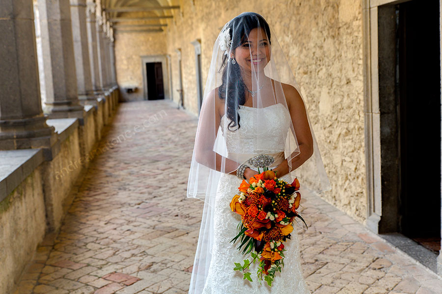The bride posing for the photographer inside Odescalchi Castle Italy