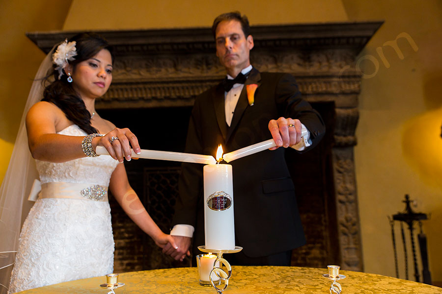 Lighting up the wedding candles of unity