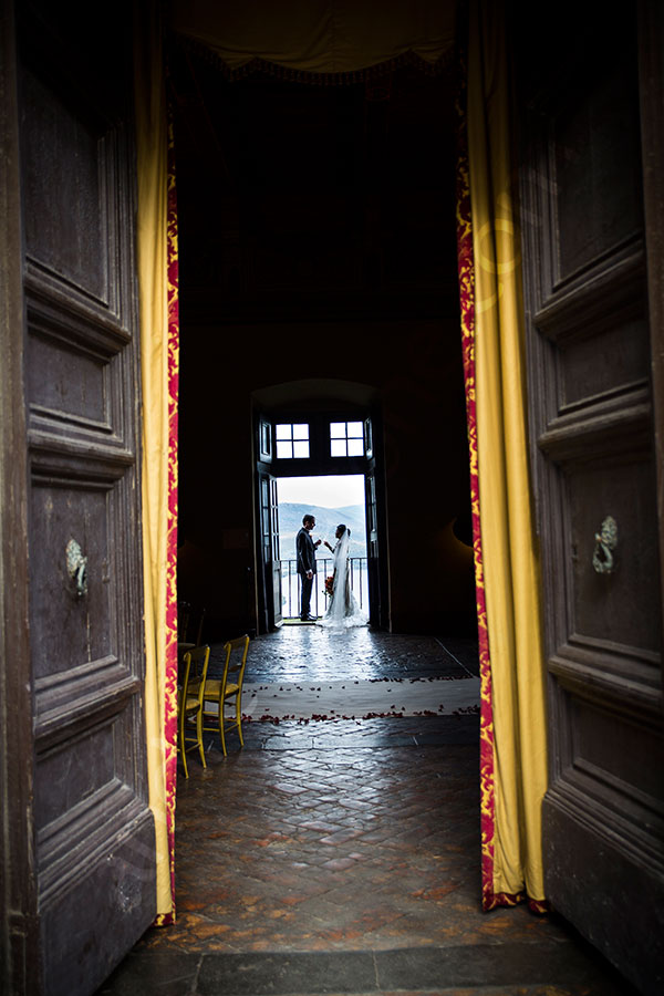 Bride and groom together inside Castello Odescalchi in Italy