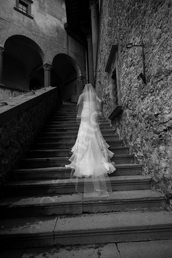Black and white photo of the bride taken in the castle