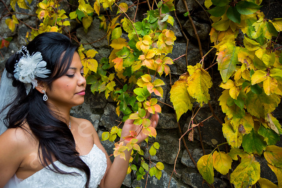 Bride photographed next to colorful ivy leaves