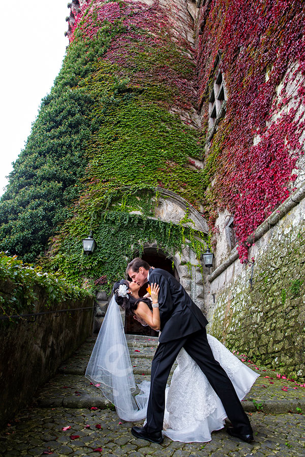 Wedding couple kissing in front of Odescalchi Castle in Italy