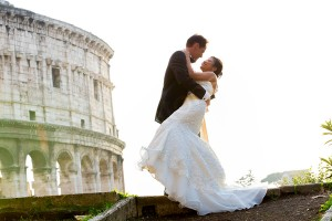 Bride and groom together the roman Colosseum in Rome Italy