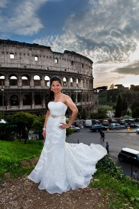 Bride posing for the photographer before the Colosseum in Rome Italy