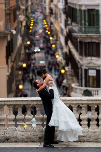 Groom lifting the bride up at the Spanish steps in Rome Italy