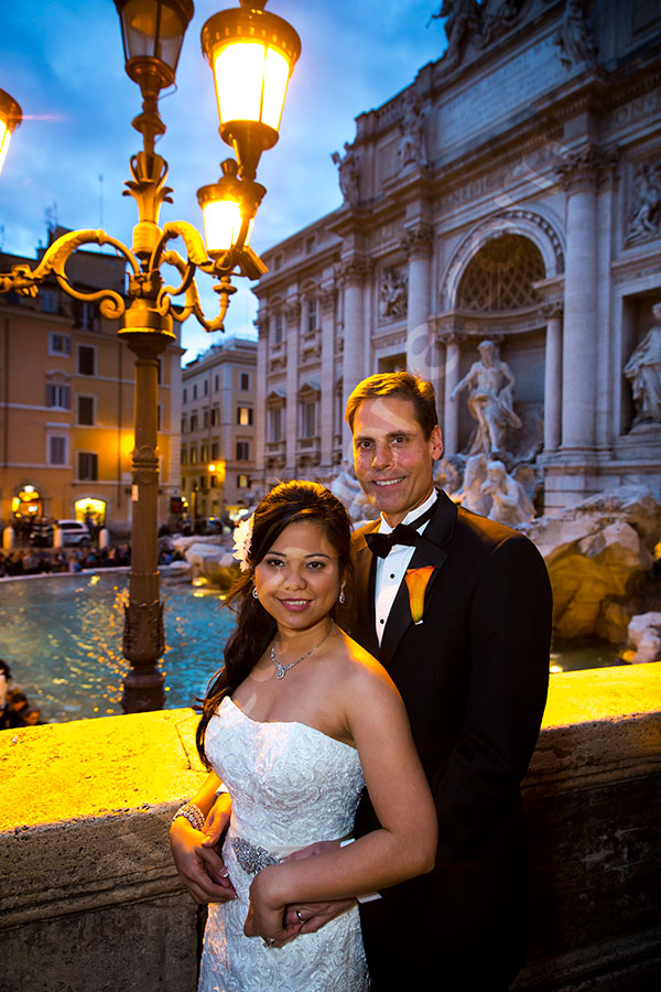 Newlyweds evening photography at the Trevi fountain in Rome Italy