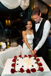Cutting the wedding cake Les Etoiles restaurant in Rome Italy