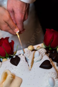 Cutting the wedding cake close up