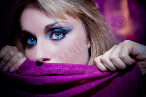 Woman face closeup during a makeup photo session in Rome