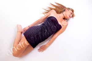 Girl laying down on white background after makeup hairstyle session in Rome