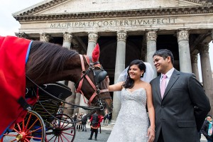 Wedding couple petting a horse at the roman Pantheon in Rome Italy