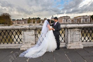 Couple photographer session on Castel Ponte Sant'Angelo in Rome Italy