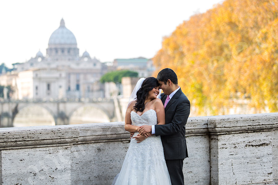 Romantic picture of a newlywed couple in front of Saint Peter's square in the Vatican city.