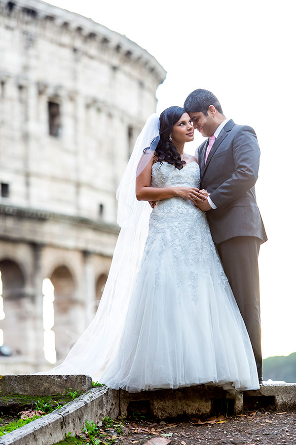 Newlyweds posing in front of the Colosseum.