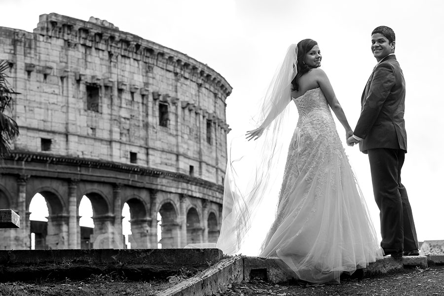 Colosseum in black and white picture. Bride and groom posing.