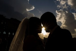 Shioulette couple kissing with the sun in between