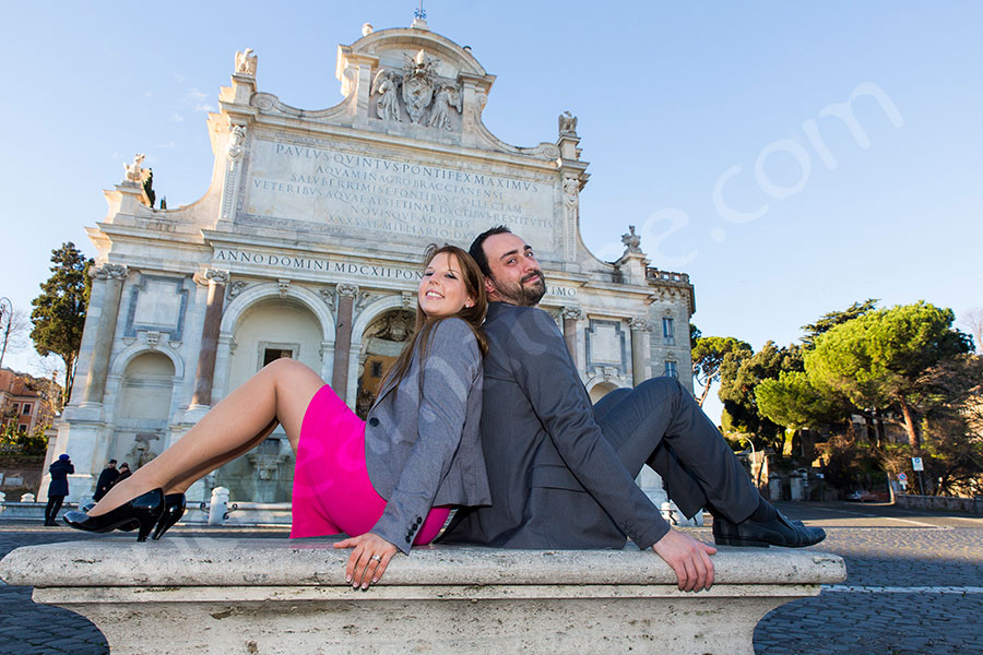 Couple engaged sitting down on a marble bench Gianicolo