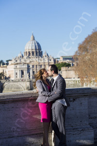 Couple together photographed from a distance with Saint Peter's dome as a backdrop