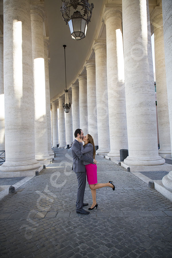Hugging in the center of the colonnade in Saint Peter's in Rome