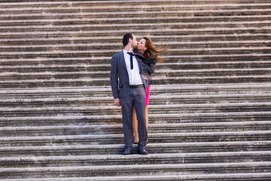 Kissing on the stairs of Piazza del Campidoglio in Rome
