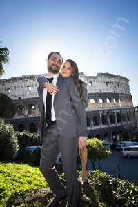 Couple posing together at the Roman Colosseum in Rome Italy