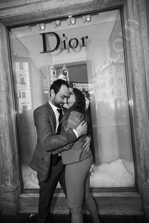 Couple in love in front of the Dior showcase