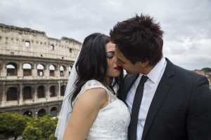 Bride and groom kissing at the Colosseum in Rome