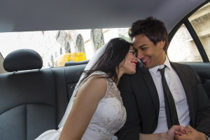 Romantic wedding picture photographed in the back of the car Color version