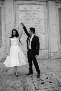 The groom spins the bride around at the Spanish steps in Rome