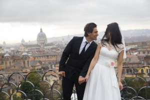 Bride and groom with the beautiful view from Parco del Pincio