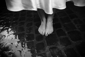 Picture of the bride's feel photographed over sanpietrini in Rome Italy black and white version