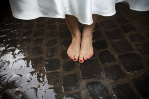 Bride's feet photographed over sampietrini in Rome Italy color vers