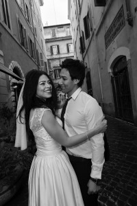 Bride and groom happy together near via Margutta in Rome