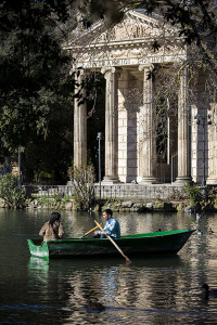 Couple rowing on a lake boat Villa Borghese Rome Italy