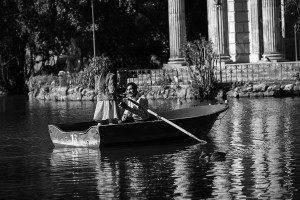 Surprise wedding asked on a boat in a lake Villa Borghese park in Rome Italy black and white version