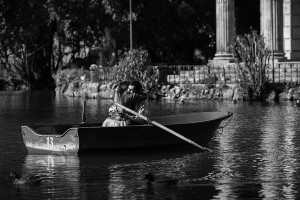 The joy and happiness after a surprise wedding proposal on an artificial lake in Villa Borghese Rome Italy b&w