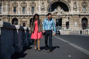 Couple walking on Ponte Umberto I bridge in Rome Italy