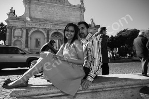 Posing sitting down in front of the Fontanone water fountain in Rome Italy b&w version