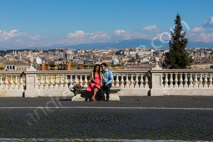 Couple photographed with the beautiful view of the city of Rome in the far distance