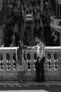 Portrait picture taken of a couple on the terrace of Trinita' dei Monti in Rome Italy b&w version
