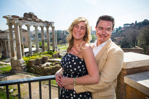 Posing for the photographer in front of the Roman Forum in Rome Italy