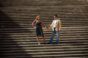 Couple standing on the stairs of Piazza del Campidoglio in Rome Italy