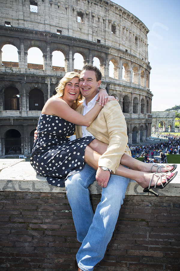 Image of a couple with the Roman Coliseum in the background