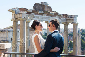 Couple celebrating their honeymoon in Rome Italy with a photographer session at the Roman Forum