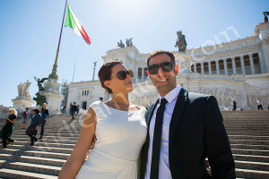 Couple posing on the stairs of Piazza Venezia in Rome Italy