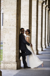 Just married couple photographed by the columns in San Ivo alla Sapienza in Rome Italy