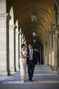 walking under the portico during a photographer session in Rome Italy
